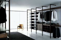 STORAGE CABINA by Piero Lissoni for Porro. A system for walk in closets with no base, back or top. A perfect solution for smaller spaces due to its open and airy feel. Made to criteria in Italy to accommodate almost any need.