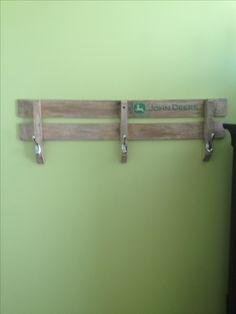 John Deere wagon side repurposed for a coat rack.