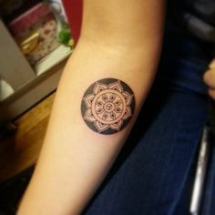 Forearm tattoo of a mandala by Jay Shin.