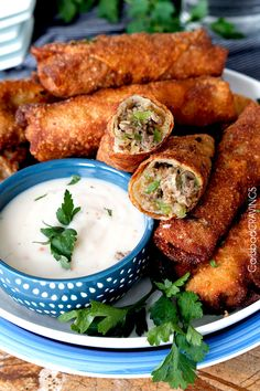 Philly Cheesesteak Egg Rolls - Thinly sliced marinated steak, bell peppers, mushrooms and jalapenos smothered with cheese then fried (or baked) to melty, cheesy perfection in a crunchy egg roll