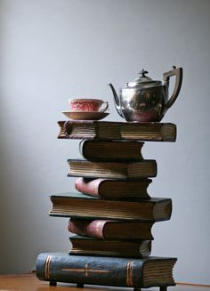 Old books and a cup of tea, simply lovely.