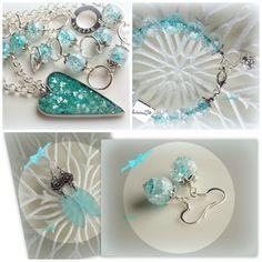 Long necklace, earrings and bracelet.