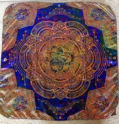 Our new tapestries are made of a thicker richer polyester material that results in a softer material with a richness of color that you must see to believe! These tapestries are multi purpose and make great bandanas, togas, shower curtains, anything you can think of these durable tapestries can do! A Portion Of Every Sale Goes Towards Supporting Artists And The Environment. We have 2 sizes available, 57inx42in and our bandana size is 29inx29in. This design is a hand drawn design by Travis…