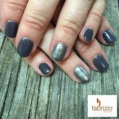 Grey nail polish shades are all the rage this season... Beautiful winter gel manicure in Jet Set gelish polish with Fancy My Tinsel accents. #getfabriziofabulousnails today #greynails #graynails #greynailpolish #wintermanicure