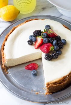 Limoncello Cheesecake with Biscoff Crust - A fabulous silky cheesecake recipe with a boozy lemon essence and crisp salty-sweet biscoff cookie crust on the