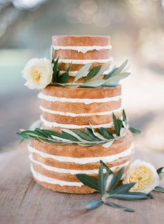 Pretty naked cake with laurel and white flowers. Beautiful and simple - the cake and i naked cake