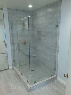I really like this stonework shower. The glass walls are really minimal and pleasing, and they go well with the stone. This would be perfect for my guest bathroom.