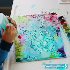Painting with Watercolors, Glue and Salt - simple and fun. The glue creates designs on top of the paint. The salt creates a pretty starburst effect by soaking up paint pigments as the painting dries. And as an extra bonus: the salt sparkles!  Sandrine Karsenty, we need to do this!! lol  seriously!