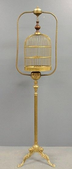 Ok, maybe too much, but I mean it would be creepy.  Brass birdcage on an elaborate stand with paw feet.