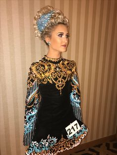 Between rounds in her Doire Designs dress designed by Meg Baffa