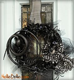 Halloween Wreath:    I REALLY hate spiders, even the fake dollar store rubber ones, but this wreath is sooo Halloween awesome, it almost makes me want to make it for my house.