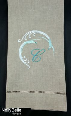 Swirling bird monogram embroidered on taupe linen/cotton guest towel. NellyBelle Designs