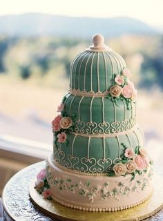 bird cage inspired tiffany blue with flower detailing tower cake.