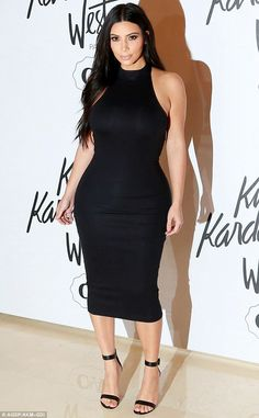 Nice curves: Kim Kardashian looked in perfect shape on Monday in Sao Paulo, Brazil, during...
