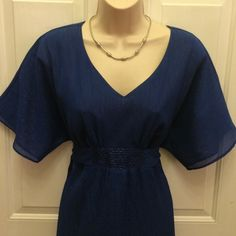 Royal Blue V Neck Top Decorative bead work around the waist with tie back sash. Royal blue (True color 1st pic) with silver threads give it a shimmer look. Never worn out. Like new. Fashion Bug Tops