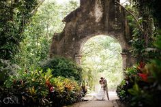 Stunning ancient arch at a Colonial Hacienda in Yucatan for a destination wedding. Mexico wedding photographers Del Sol Photography, photo by Marina