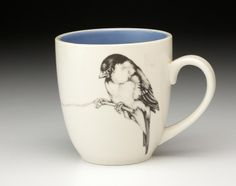 Mug-Chickadee: Laura Zindel's ceramics are functional works of art. This Chickadee Mug is great for sitting down and enjoying your morning cup of coffee and tea. These dinnerware products are made from high resistance china. This dinnerware is microwave and dishwasher safe. These collectible Mugs are the perfect gift for your little chickadee or your favorite bird watcher or wildlife enthusiast. Finely detailed bird illustrations by our friend Laura Zindel.