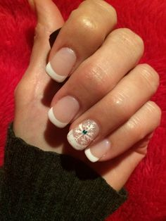 French manicure with snowflake design.