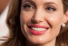 Ahh, Angelina Jolie.  Perfect smile? No.  But she is gorgeous and so is her smile!  Smile on people.