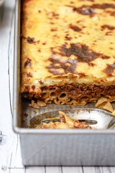 Greek Pastitsio Recipe | The Mediterranean Dish. A delectable Greek baked pasta casserole with flavor-packed meat sauce and a creamy bechamel topping. This is a lightened up pastitsio recipe that is every bit as indulgent with only 230 calories per serving. And it serves a crowd! See the full recipe on TheMediterraneanDish.com