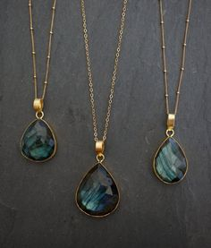Labradorite bezel gemstone necklace with so much color and fire (iridescent sheen Labradorite is known for.) Every piece has lots of fire (iridescent sheen and flash) and is unique.