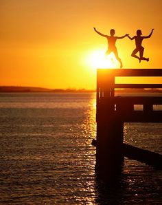 jumping off a dock during sunset, and getting the moment captured on film. add that to my list of things to do.
