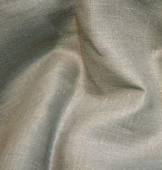 Medium grey colored linen in a natural linen fabric. This is my top choice with the mercury glass, fancy glass, and brass pieces. It has a rustic elegant look.