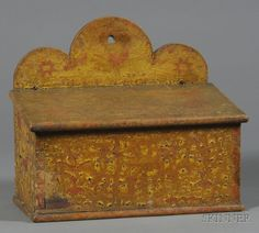"Paint Decorated Lift-top Wall Box, America, early 19th century, painted mustard yellow with red tulips, birds, and six-point star designs, one side with the initials ""C. H.,"" ht. 11 3/4, wd. 13 1/2 in."