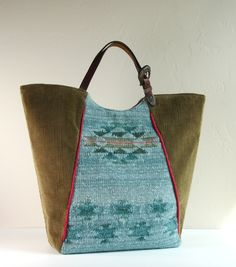 Large shopper tote made from upcycled sweater, corduroy pants and western-style belt handles. https://www.etsy.com/shop/karenlukacs