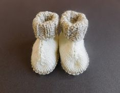 Couldn't decide whether to call these Hug Boots or H'ugg Boots ! They do look a little like Ugg Boots don't they . Baby Hug Boots Baby Hug Boots Baby H'Ugg Boots Baby Booties Knitting Pattern, Baby Boy Knitting Patterns, Baby Hats Knitting, Baby Patterns, Crochet Patterns, Free Knitting, Knitted Baby Boots, Knitted Booties, Gestrickte Booties