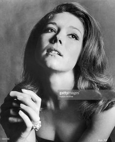 Studio portrait of British actor Diana Rigg, clasping her hands and looking up. She was appearing in director Peter Hunt's film, 'On Her Majesty's Secret Service.'