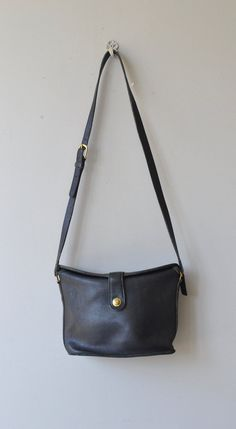 Vintage black leather Coach bag, called the Binocular bag, with original brass turn clasp, unique fold over top with pull/spring closure, large