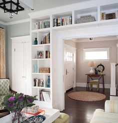 entryway bookshelves- anyone can do these.  they always look great, don't cost a fortune, and really add storage