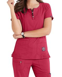 Koi Lite Serenity tops feature a double zipper neckline, ribbed contrast panels and four handy pockets. Shop Scrubs & Beyond to get this style. Cute Scrubs Uniform, Scrubs Outfit, Stylish Scrubs, Medical Scrubs, Nurse Scrubs, Koi Scrubs, Medical Uniforms, Uniform Design, Scrub Pants