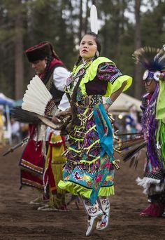 Navajo Jingle-dress dancer Yanabah Redhouse dances during the 16th Annual Pow Wow in in Pinetop, Ariz. (Photography by Diego James Robles)