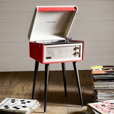 Retro style that's ready to play. This two-speed turntable features convenient, built-in speakers to eliminate wires and extra equipment. Retro Room, Built In Speakers, Phonograph, Drafting Desk, Ny Times, Turntable, Hearth, Plays, Nest