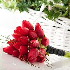 red tulip bouquets for isle then extended to centerpiece idea.
