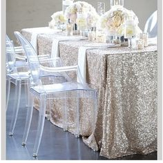 I absolutely hate plain white table line. Can we try something neutral sparkly like this? With white/green napkins? or center strolls?