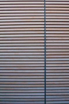 Horizontal wood (composite?) slat wall