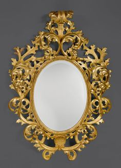 OVAL MIRROR, Louis XV, Northern Italy, ca. 1750. Wood, pierced and opulently carved and gilt. Gilding restored. Mirror glass, later - Dim: H 175 cm. W 122 cm.