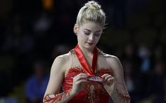 Gracie Gold looks at her silver medal after performing in the Skate America ladies competition Saturday.