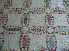 I quilted a feather in the centre of the plain fabric, and small meandering around which made all the Liberty fabrics pop. Addicted to Quilts