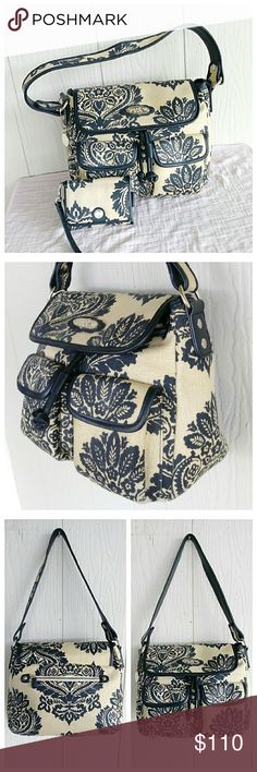 """Spartina 449 Linen Bag + Wallet Authentic Spartina two piece bundle made of thick woven linen. The bag features one main compartment with a zipper pouch, 2 slip pockets, two front snap pouches and an outer rear zipper pocket. The wristlet wallet has 3 CC slots, DL window and a pouch that will fit a phone measuring 4.5"""" x 3"""". Includes hang FOB. Bag - 9"""" H x 11"""" L x 5"""" W + 10"""" drop Wristlet - 5"""" x 3.5"""" 💥 Reasonable Offers Accepted 💥 Spartina 449 Bags Shoulder Bags"""