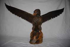 A Fabulous Large Fine Carved Wood Black Forest Eagle Sculpture Standing on a Rock, from circa 1930/40.