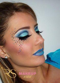 Dramatic blue cut crease makeup. Subtle small rhinestones frame eyes