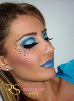 Dramatic blue cut crease makeup.