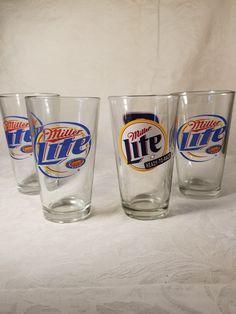 4 Miller Lite glasses