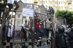 Anti-Mursi protesters shout slogans outside the Supreme Court in Cairo, June 3, 2013, where judges are holding a protest against a new law currently under discussion at the Shura council, claiming the law should be discussed in the Parliament.