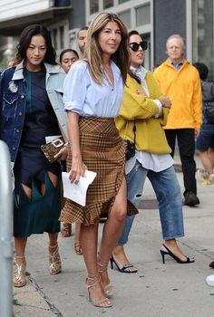Nina Garcia wore a tartan skirt paired with a button-down shirt