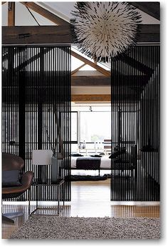 Use Panel Track Blinds as a Modern Room Divider! How Creative!